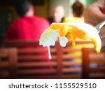 cutted fried egg  on fork with... | Shutterstock . vector #1155529510