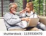 senior couple relaxing and... | Shutterstock . vector #1155530470