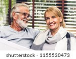 senior couple relaxing and... | Shutterstock . vector #1155530473