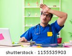 young doctor sitting in...   Shutterstock . vector #1155535903