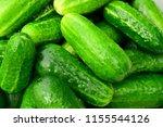 lots of green cucumbers. clean... | Shutterstock . vector #1155544126