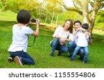 asian family taking photo in...   Shutterstock . vector #1155554806