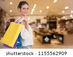 cheerful young woman holding... | Shutterstock . vector #1155562909