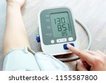 woman check blood pressure... | Shutterstock . vector #1155587800