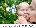 mother hugging and kissing... | Shutterstock . vector #1155591043