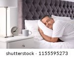 man sleeping on comfortable... | Shutterstock . vector #1155595273