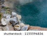 the edge of kamado jigoku pond... | Shutterstock . vector #1155596836