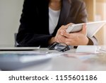 woman with bills and calculator.... | Shutterstock . vector #1155601186