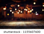 image of wooden table in front... | Shutterstock . vector #1155607600