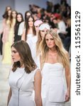 """Small photo of KIEV, UKRAINE - OCT 10: Models poses at the runway during Fashion Show by """"Nadya Dzyak"""" ; by fashion designer Nadya Dzyak as part of Ukrainian Fashion Week, October 10, 2012 in Kiev, Ukraine."""