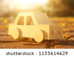 old wooden toy car on the road...   Shutterstock . vector #1155614629