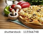 Pizza With Mushrooms And...