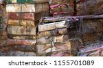pile of old books damaged by... | Shutterstock . vector #1155701089