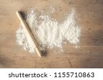 rolling pin and flour on wooden ... | Shutterstock . vector #1155710863