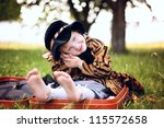 little beautiful girl in hat... | Shutterstock . vector #115572658