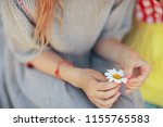 Small photo of hope, girl guessing on chamomile / baby with chamomile flower, concept divination hope love love friendship