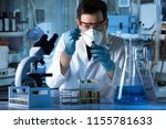 scientist with a dropper... | Shutterstock . vector #1155781633