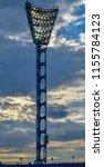 floodlight poles in a sports... | Shutterstock . vector #1155784123