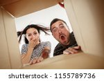 the surprised man and woman... | Shutterstock . vector #1155789736