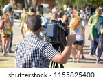 behind the scene. cameraman... | Shutterstock . vector #1155825400