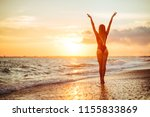 carefree woman dancing in the... | Shutterstock . vector #1155833869