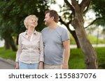 beautiful eldery woman and her... | Shutterstock . vector #1155837076