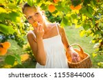 pretty  young woman picking... | Shutterstock . vector #1155844006