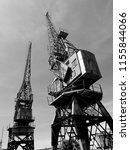 old dockyard cranes on the docks | Shutterstock . vector #1155844066