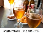 beer glasses with plates to eat ... | Shutterstock . vector #1155850243