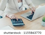 old lady boss accountant typing ... | Shutterstock . vector #1155863770