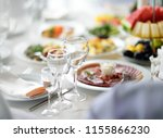 beautiful table set with three...   Shutterstock . vector #1155866230