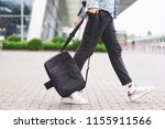 young handsome man with a bag... | Shutterstock . vector #1155911566