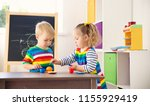 little children playing with... | Shutterstock . vector #1155929419