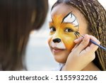 Children face painting. artist...