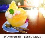 yellow ice shaved in glass bolw ... | Shutterstock . vector #1156043023