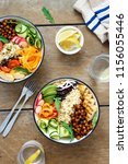 top view two buddha bowl with... | Shutterstock . vector #1156055446