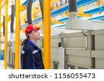 worker in a factory wearing...   Shutterstock . vector #1156055473