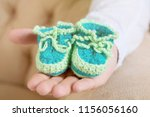 hand holding adorable tiny... | Shutterstock . vector #1156056160