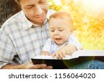 young father with his son... | Shutterstock . vector #1156064020