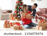 young man surprising his... | Shutterstock . vector #1156070476
