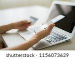 woman hands holding credit card ... | Shutterstock . vector #1156073629