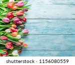 colorful  bouquet of tulips on... | Shutterstock . vector #1156080559
