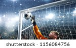 goalkeeper tries to save from a ... | Shutterstock . vector #1156084756