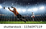 attacker scores a goal and... | Shutterstock . vector #1156097119