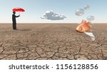 man and floating fish in desert....   Shutterstock . vector #1156128856