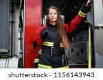 photo of young fire woman with...   Shutterstock . vector #1156143943