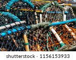 lobster pots on the quayside at ...   Shutterstock . vector #1156153933