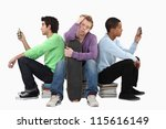 bored teenagers sat on piles of ... | Shutterstock . vector #115616149
