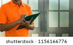 Small photo of Delivery man chek list item on note scrip.