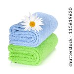 Blue and green towels and camomile flower. Isolated on white background - stock photo